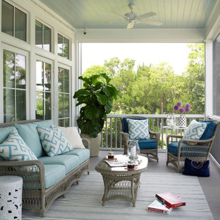 Photo of a coastal screened veranda in Charleston with decking and a roof extension.