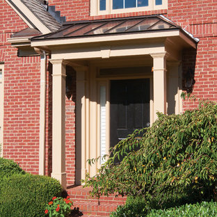 Classic front porch idea in Atlanta with a roof extension