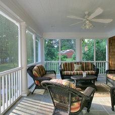 Tropical Porch Potomac, MD Brick Ranch Home to Nantucket Style