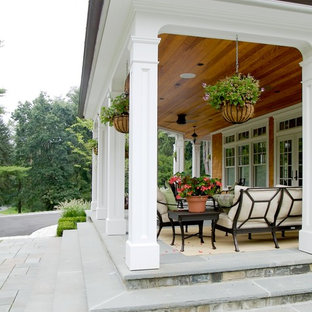 Inspiration for a timeless porch remodel in New York with a roof extension