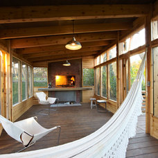 Rustic Porch by M Valdes Architects PLLC