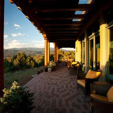 Mediterranean Porch by Woods Design Builders