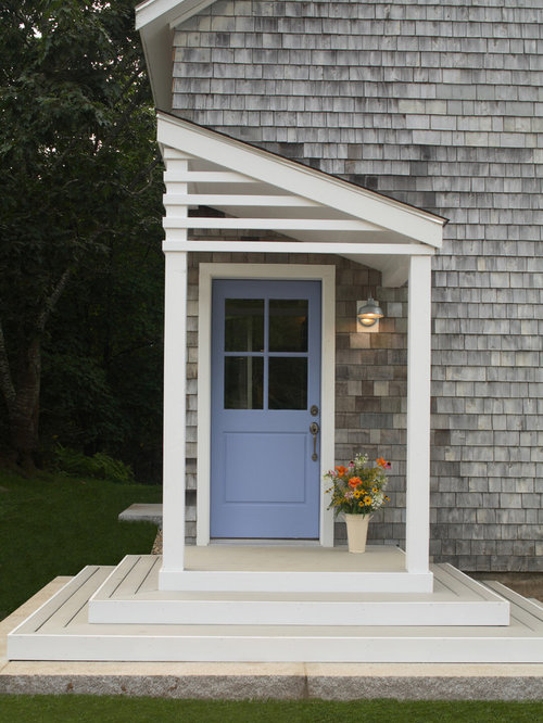trendy porch photo in portland maine with a roof extension