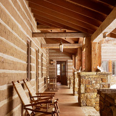 Rustic Porch by Carney Logan Burke Architects