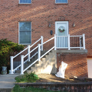 Mid-sized transitional front porch photo in Other