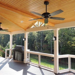 This is an example of a large craftsman porch design in Charlotte with decking and a roof extension.