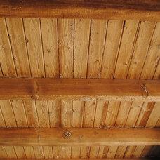 Traditional Porch by Woodland Custom Beam Company
