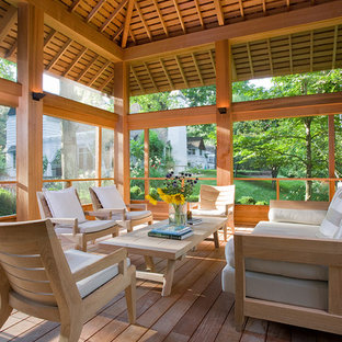 This is an example of a transitional screened-in porch design in New York.