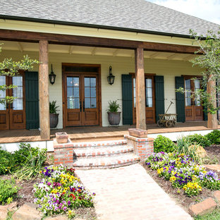 Elegant porch photo in New Orleans with decking and a roof extension