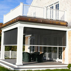 Traditional Porch by Shade And Shutter Systems, Inc