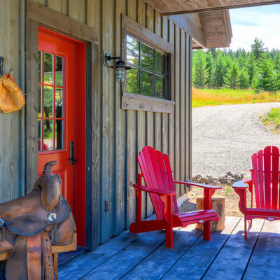 Inspiration for a rustic front porch remodel in Seattle with decking and a roof extension