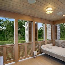 Mediterranean Porch by Maison de Reve Builders LLC
