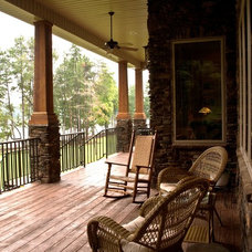 Rustic Porch by Triangle Homebuilders, Inc.