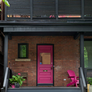 Inspiration for a mid-sized eclectic front porch remodel in Toronto with a roof extension
