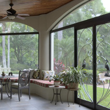 Eclectic Porch by Interiors Unleashed