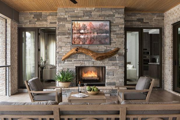 Rustic Porch by RiverWorks Design Studio