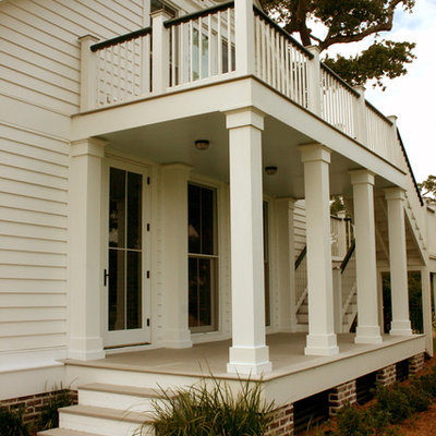 Classic porch idea in Other with a roof extension