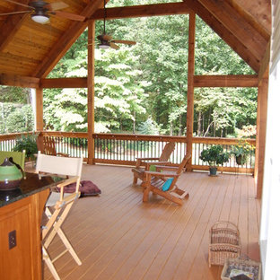 This is an example of a transitional porch design in Atlanta.