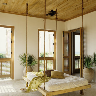 This is an example of a large tropical tile screened-in back porch design in Miami.
