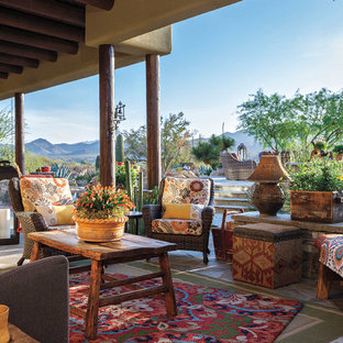 Inspiration for a southwestern porch remodel in Phoenix with a fireplace and a roof extension