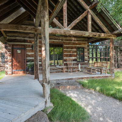 Mountain style front porch idea in Other with decking and a roof extension