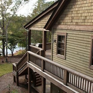 This is an example of a huge craftsman porch design in Other with decking.