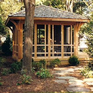 Foto di un portico stile rurale dietro casa e di medie dimensioni con pedane e un portico chiuso