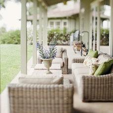 Rustic Porch by AYI & ASSOCIATES