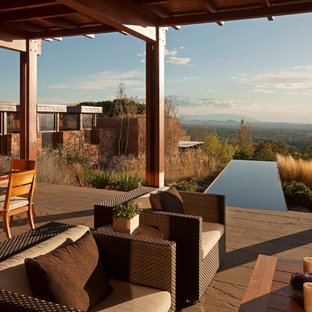Large southwest porch idea in Albuquerque with a pergola