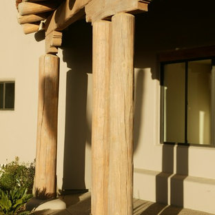 Inspiration for a mid-sized timeless concrete porch remodel in Phoenix with a roof extension