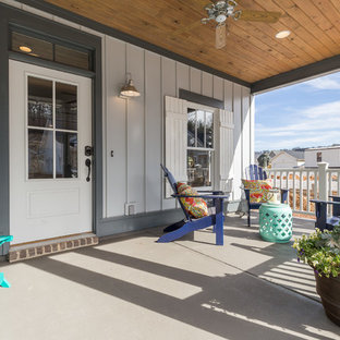 Inspiration for a mid-sized timeless concrete front porch remodel in Birmingham with a roof extension