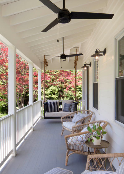 Farmhouse Porch by Garrison Foundry Architecture + Decor