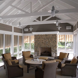 Inspiration for a mid-sized contemporary screened-in side porch remodel in Chicago with a roof extension and decking