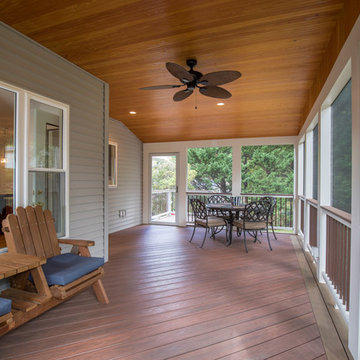 Screen porch with Wolf decking and T&G ceiling, recessed lights and ceiling fan.