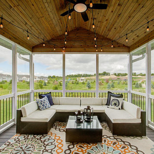 Transitional screened-in porch photo in Other with decking