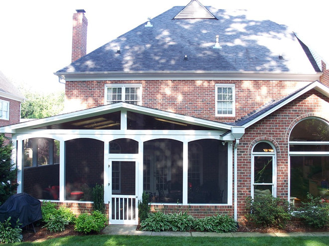 Traditional Porch by Kolby Construction Company