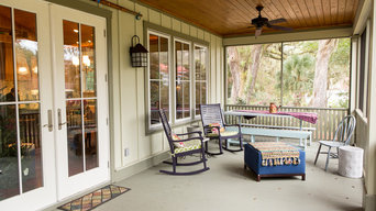screened in porch with wood ceiling