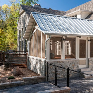 Inspiration for a timeless porch remodel in Indianapolis with a roof extension