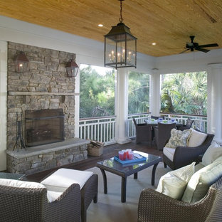Elegant porch photo in Charleston with a fire pit