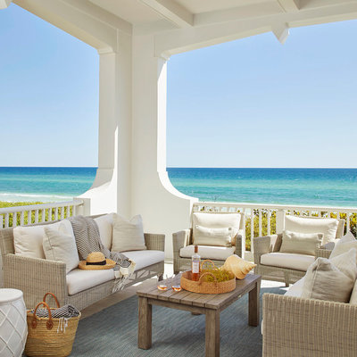 Beach style porch idea in Tampa with a roof extension