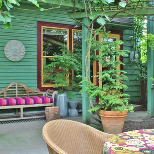 Inspiration for an eclectic concrete porch remodel