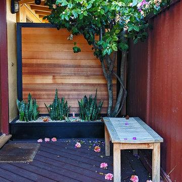 Secured Custom Steel Framed Gates with Slab Accent Garden Wall