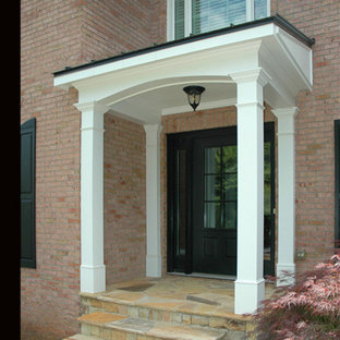 Inspiration for a small timeless front porch remodel in Atlanta with a roof extension
