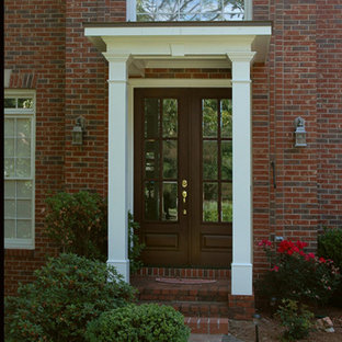 Small elegant front porch photo in Atlanta with a roof extension