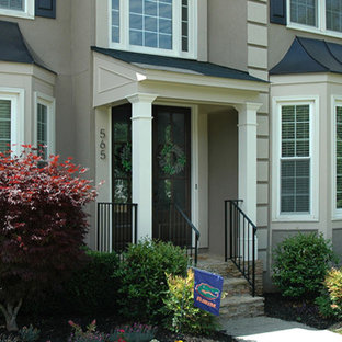 Small classic front porch idea in Atlanta with a roof extension