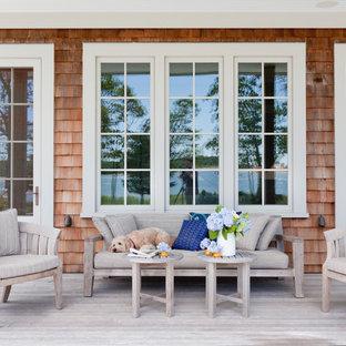 Coastal porch idea in New York with decking