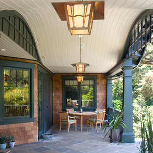 Arts and crafts porch photo in San Francisco with a roof extension