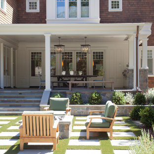 Inspiration for a craftsman stone porch remodel in San Francisco with a roof extension