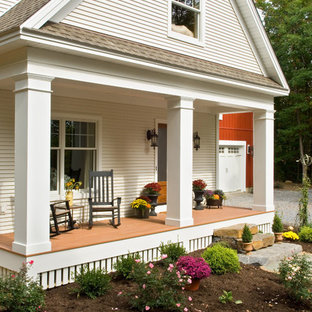Ornate porch idea in New York with a roof extension