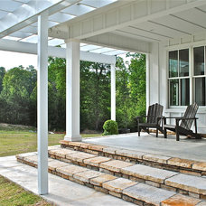 Traditional Porch by Sideco Inc.